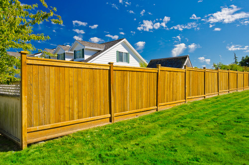 Wooden fence with houses behind it